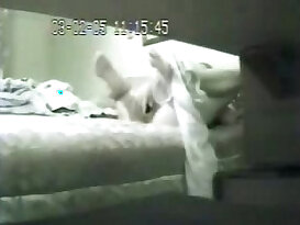 My mom on bed using dildo caught by hidden cam