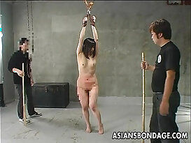 Asian slut getting spanked and she screams