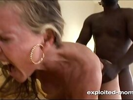 Blonde Milf gets her Back Blown Out by a Big Black girl with huge monster Cock in her Video
